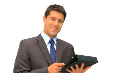 Businessman checking his touch pad against a white background