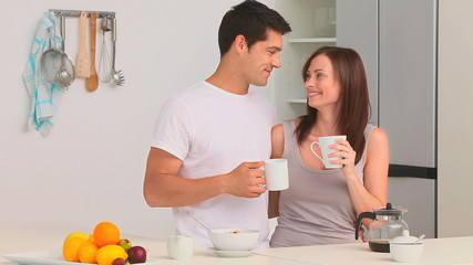 Couple drinking a cup of coffee in the kitchen