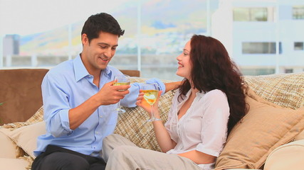 Couple drinking wine in the living room