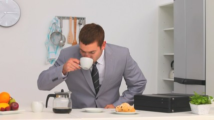 Businessman drinking his coffee before go to his work