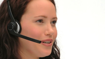 Young businesswoman in a call center
