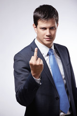 "A young man in a suit shows a ""fack"""