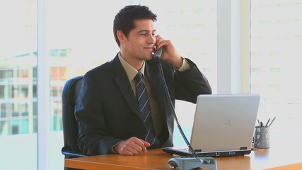 Bussinessman phoning in his office