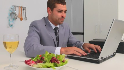 Businessman working on his laptop at lunch time