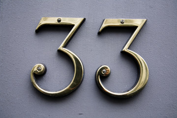 brass number 33