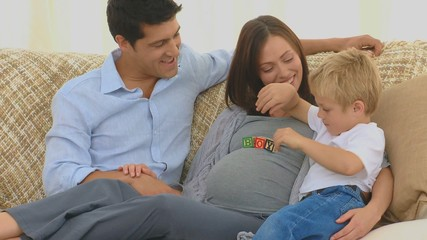 Pregnant woman with her husband and her son