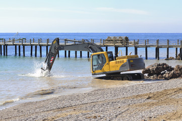 Bulldozer Rebuilds Rocky Beach before season