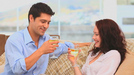 Handsome couple drinking a glass of white wine