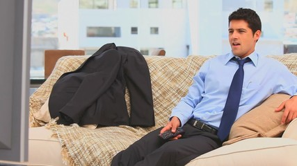 Businessman after work watching tv