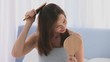 Brunette tidying her hair during the morning