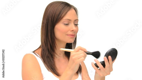 Coquette woman putting on make-up