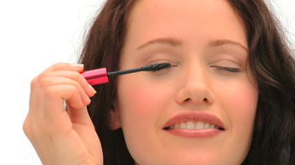 Brown-haired woman putting make-up