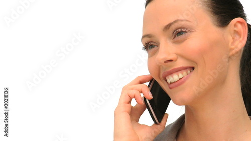 Woman using a smartphone to take a call