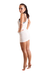 Full-length portrait of sexy young woman in white dress