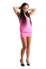 Full-length portrait of sexy young woman in pink dress