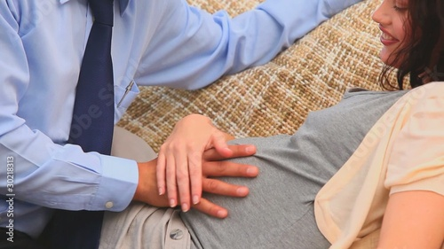 Man stroking the belly of his pregnant wife
