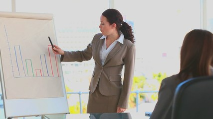Business woman using a blackboard