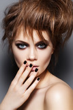 Fototapety Fashion model with tousled hair, make-up, manicure