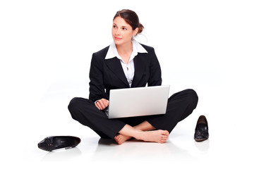 Young business woman sitting on the floor with laptop II