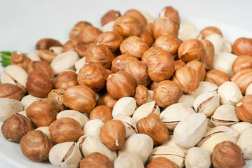 Background of ripe brown hazelnuts over wooden table
