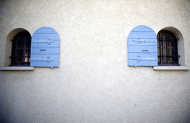 small windows with blue shutters