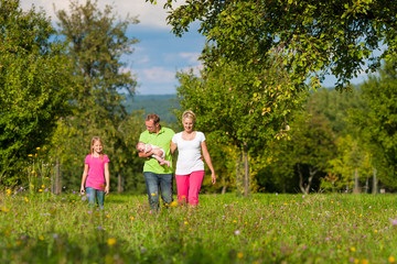 Family with kids having walk in summer