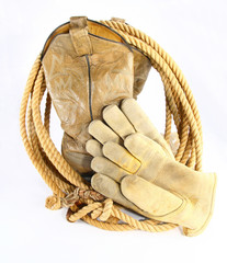 Cowboy boots with rope and work gloves