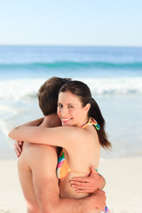 Lovely couple hugging on the beach