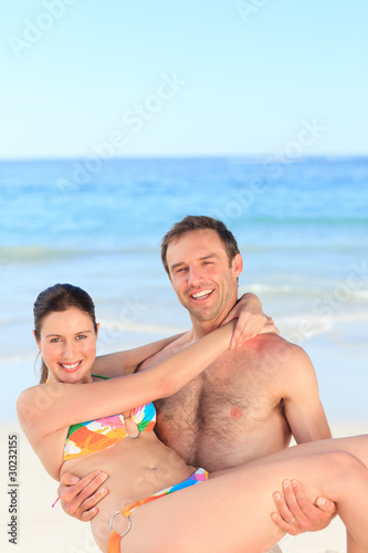 Man with his wife on the beach