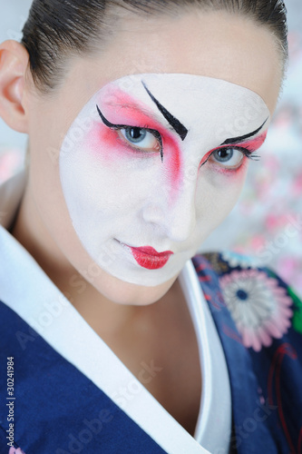 close-up artistic portrait of japan geisha woman with creative m
