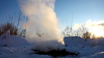 steam from water system and winter sky in russia