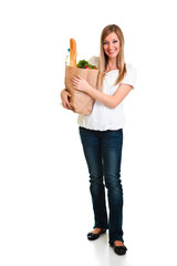 Woman carrying bag of groceries isolated on white