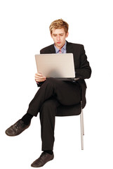Male traveler busy on laptop