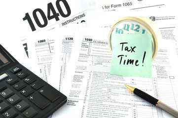 Tax Time. The Concept Image with a calculator and  a clock.