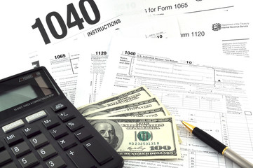 Tax Season! The  Concept Image with a calculator, money and tax