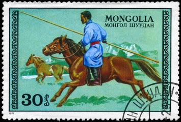 MONGOLIA - CIRCA 1977 Hunter on horseback
