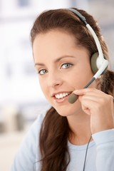 Portrait of pretty dispatcher with headphones