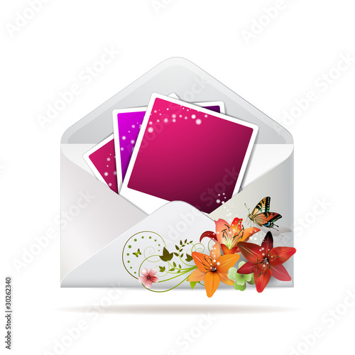 Blank colored photos in envelope decorated with flowers