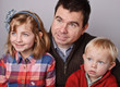 beautiful father with his son and daugther portrait