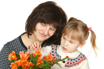 Grandmother and granddaughter intently looking petals