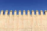 Crenulated wall at the Royal Palace in Fes poster