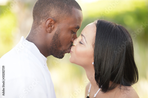Young couple kissing in a nature setting
