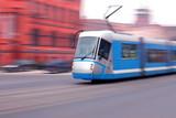 Modern  blue tram rider fast on rails