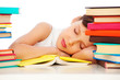 fatigued schoolgirl sleeping on book