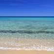 Horizon over an idyllic beach with clear blue water