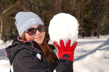 Girl with a very big snowball