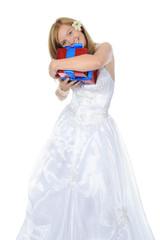 Bride hugging gift box.