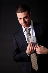 Businessman holding four aces