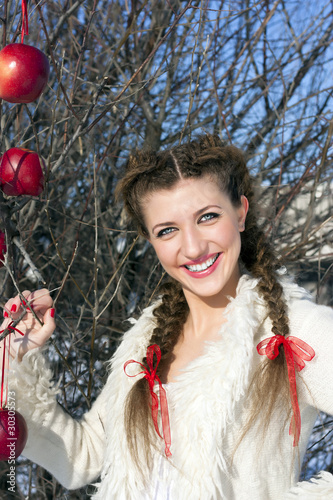 Beautiful young woman with apple