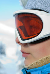 Young woman face in ski mask